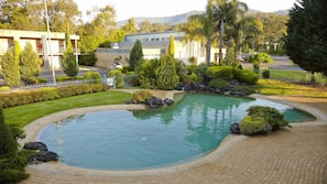 Outdoor pool, open 9 AM to 9 PM, pool loungers