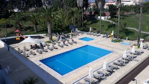 2 outdoor pools, pool umbrellas, pool loungers