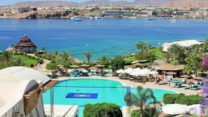 Outdoor pool, open 8:30 AM to 5:30 PM, pool umbrellas, sun loungers