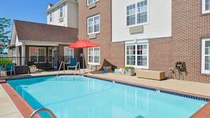 Seasonal outdoor pool, open 10 AM to 9:00 PM, pool umbrellas