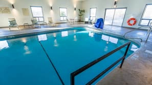 Indoor pool, open 7:30 AM to 10:00 PM, pool umbrellas