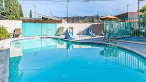 Outdoor pool, open 10:00 AM to 9:00 PM, pool umbrellas, sun loungers