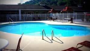 Seasonal outdoor pool, open 9 AM to 9:00 PM, pool umbrellas
