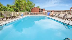 Seasonal outdoor pool, open 9 AM to 11 PM, pool umbrellas, sun loungers