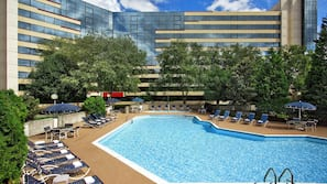 Seasonal outdoor pool, open 9:00 AM to 11:00 PM, pool umbrellas