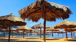 On the beach, beach cabanas, beach umbrellas, scuba diving