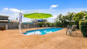 Outdoor pool, open 8 AM to 7:00 PM, pool umbrellas, pool loungers