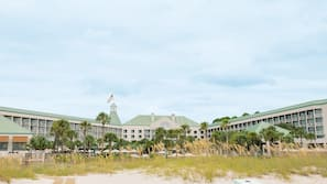 On the beach, white sand, beach towels, beach volleyball