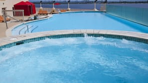 Outdoor pool, open 8:00 AM to 10:00 PM, cabanas (surcharge)