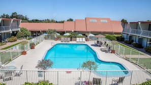 Seasonal outdoor pool, open 9 AM to 8:30 PM, pool umbrellas
