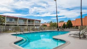 Seasonal outdoor pool, open 9 AM to 8:30 PM, pool umbrellas