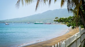On the beach, black sand, beach massages, beach bar