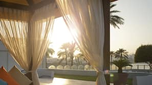 Outdoor pool, open 7 AM to 9 PM, free cabanas, pool umbrellas