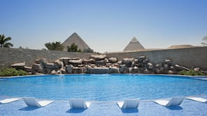 2 outdoor pools, open 8:00 AM to 5:30 PM, pool umbrellas, pool loungers
