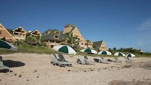 Private beach, white sand, sun loungers, beach umbrellas