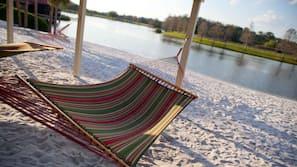 White sand, beach umbrellas, beach towels, sailing