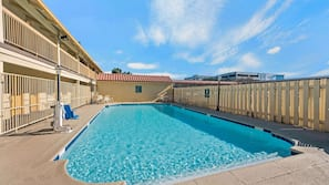 Outdoor pool, open 10:00 AM to 10:00 PM, pool loungers