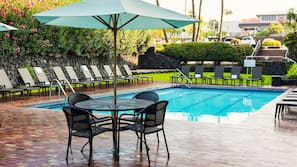 Outdoor pool, open 9:00 AM to 6:00 PM, pool umbrellas