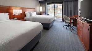 Premium bedding, down duvets, memory-foam beds, in-room safe
