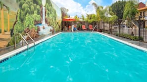 Outdoor pool, open 9 AM to 10 PM, pool umbrellas, sun loungers