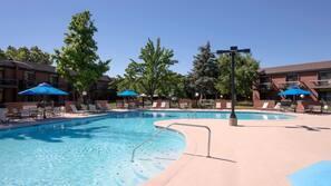 Seasonal outdoor pool, open 10:00 AM to 10:00 PM, pool umbrellas