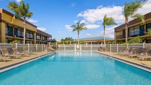Outdoor pool, open 6 AM to 8:00 PM, pool umbrellas, sun loungers