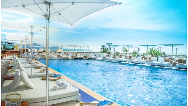 Seasonal outdoor pool, open 8:00 AM to 6:00 PM, pool umbrellas