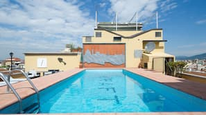 Outdoor pool, open 9 AM to 8 PM, pool loungers