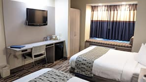Hypo-allergenic bedding, pillow top beds, desk, laptop workspace