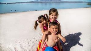 On the beach, beach volleyball, kayaking