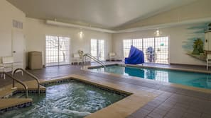 Indoor pool, open 8:00 AM to 11:00 PM, pool umbrellas, sun loungers