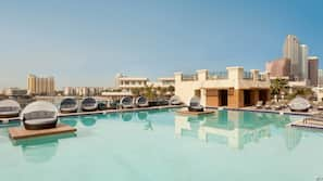 Outdoor pool, open 6:00 AM to 10:00 PM, cabanas (surcharge)
