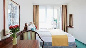 Premium bedding, down comforters, free minibar, in-room safe