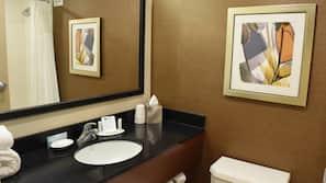 Designer toiletries, hair dryer, towels
