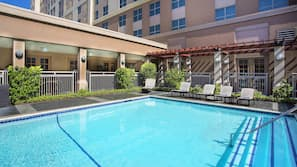 Outdoor pool, open 10:00 AM to 11:00 PM, pool loungers