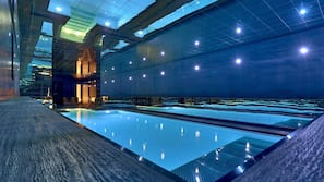 Indoor pool, open 9:00 AM to 8 PM, pool umbrellas, sun loungers