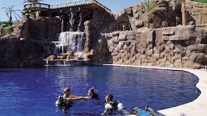4 outdoor pools, open 7:00 AM to 6:00 PM, pool umbrellas, sun loungers