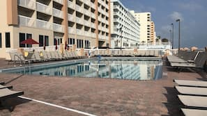 Outdoor pool, open 9:00 AM to 11:00 PM, pool umbrellas, pool loungers