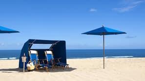 On the beach, beach cabanas, beach umbrellas, beach towels
