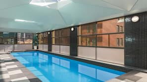 Indoor pool, open 7:00 AM to 7:00 PM, pool loungers
