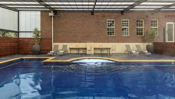 Seasonal outdoor pool, open 6:00 AM to 9:00 PM, pool loungers