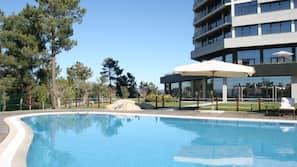 Indoor pool, seasonal outdoor pool, open 8 AM to 9 PM, sun loungers
