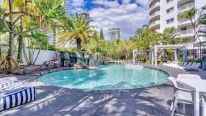 Outdoor pool, open 9:00 AM to 5:00 PM, pool loungers