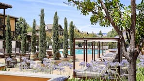 Outdoor pool, open 8 AM to 10 PM, cabanas (surcharge), pool umbrellas
