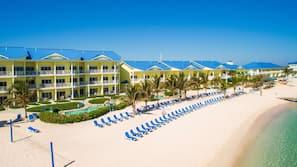 On the beach, white sand, sun loungers, beach towels