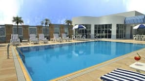 Seasonal outdoor pool, open 8:00 AM to 6:00 PM, pool loungers