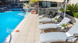 Outdoor pool, open 6 AM to 9 PM, pool umbrellas, sun loungers