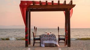 On the beach, sun loungers, beach towels, 2 beach bars