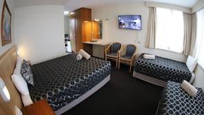 Premium bedding, pillow top beds, blackout curtains, iron/ironing board