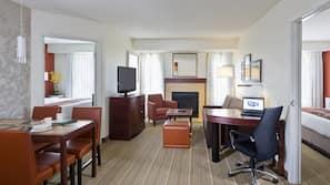 Pillowtop beds, desk, blackout drapes, iron/ironing board